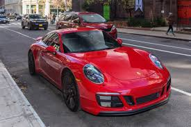 carmine red porsche porsche 911 carrera gts review pictures america richest