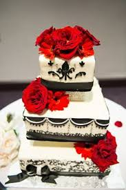 traditional three tiered wedding cake with touches of red and