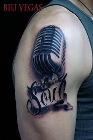 grey microphone tattoo on right shoulder