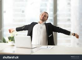 desk exercises at the office businessman stretching out desk laptop office stock photo