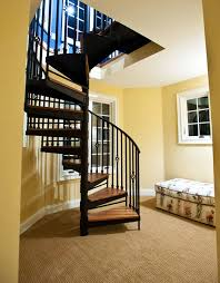 indoor black metal spiral staircase mixed laminate wood floor and