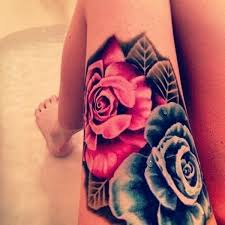 blue and tattoos on left thigh