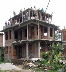 file building a house nearby the street between kathmandu and