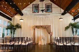 wedding arch kent indoor wedding ceremony setup with arch and drapes kent island