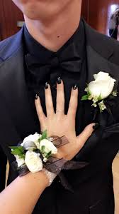 black and white corsage white black wrist corsage and boutonniere to match in pleasanton