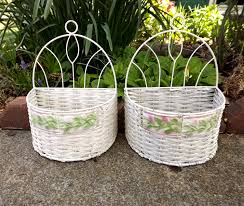 white basket set of 2 white wicker wall baskets with pink and
