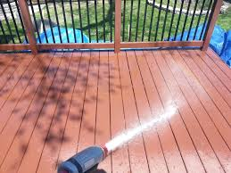 wet down applying deck stain with a garden sprayer olympic cleaner