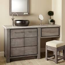 blackvessel sink vanity with grey wooden makeup cabinet with