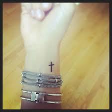 cross tattoo on pulse http pinterest com ericaohare tattoos