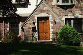 tudor house style dutch colonial black front door maplewood tudor entry ideas