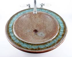handcrafted sinks add a personal touch to any bathroom kukun