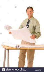 Drafting Table Blueprints Arcitect Standing At Drafting Table Holding Blueprints Stock Photo