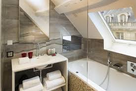 exciting attic bathroom design styling with smooth white deep tub