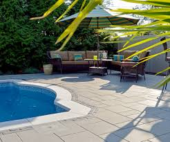 Long Island Patio by A Poolside Oasis In Long Island Ny Features Unilock U0027s Umbriano