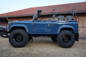 land rover classic lifted rhd defender 90 soft top in arles blue 5 inch lift michelin