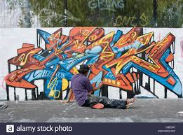 teenage wall murals uk home design ideas teenage boy painting abstract graffiti art mural on wall from rear