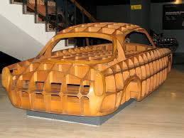 car made out of wood exhibited at the national museum of cars