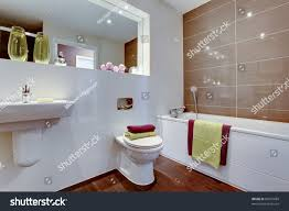 Contemporary Bathroom Suites - chic contemporary bathroom suite brightly coloured stock photo