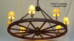 wagon wheel light fixture ww025 wagon wheel chandeliers with uplights