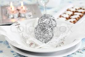red and silver christmas table settings christmas table setting in white and silver tone stock photo
