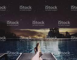 Pool At Night Man Feet On Bed At Swimming Pool At Night Stock Photo 625130678