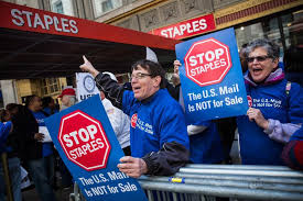 Postal Service will end controversial partnership with Staples     Unionized Postal Service workers protested outside a Staples store in April