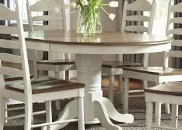 springfield honey and cream extendable pedestal dining table from