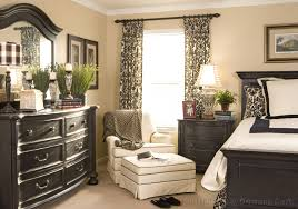 traditional neutral bedroom with black and cream window curtain