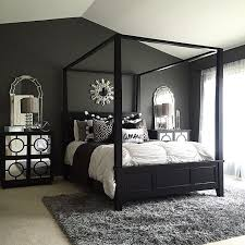 mid century style bedroom with small black nightstand and drum