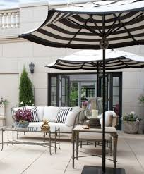 best outdoor patio umbrellas a twist on the expected the well Best Patio Umbrella For Shade