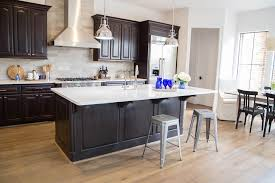 brown kitchen cabinets to white tired of your kitchen s stale espresso colored cabinets do