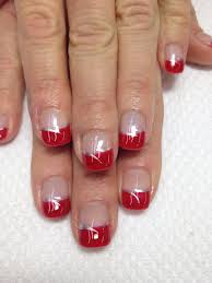 such pretty holiday nails a bright red gel french accented with