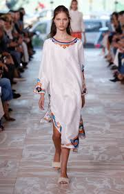 a runway look from the tory burch spring summer 2017 fashion show