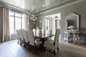 dark wood dining table with gray french dining chairs french