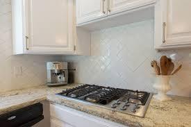 kitchen white brick backsplash mushroom kitchen cabinets
