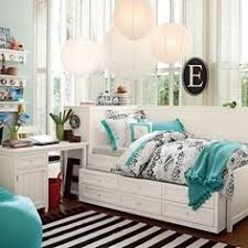 full size daybed with trundle storage and white nightstand