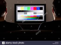 test pattern media two men watching a test pattern on a television stock photo royalty