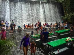 unique restaurant in the philippines sits at the base of a waterfall