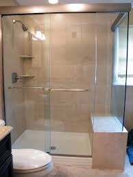 bathroom corner glass shower enclosure with black door handle and