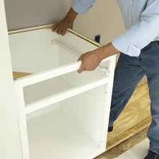 how to raise cabinets the floor install base cabinets