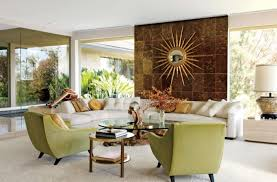 room with sunburst mirror and unique center table