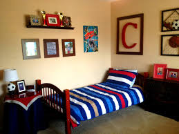 red blue sports themed boys bedroom with blue stripes pillow and
