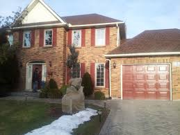 should garage door match window color or trim color