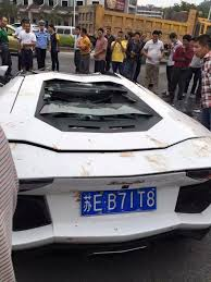 crashed red lamborghini lamborghini aventador collides with a mud truck in china