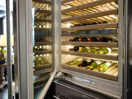 chic built in wine fridge featuring brown wooden kitchen cabinets