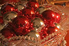 and silver ornaments in cut glass bowl stock photo