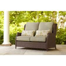 brown jordan vineyard patio loveseat with meadow cushions and