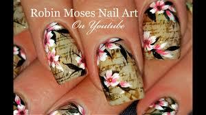 faux vintage newsprint and flowers nails antique nail art design