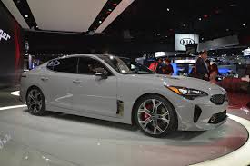 2018 kia stinger looks like a porsche panamera in nardo gray paint