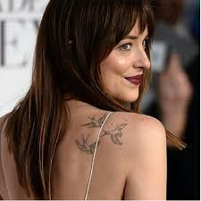 dakota johnson regrets her tattoos celebrity news